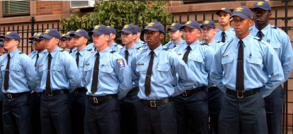 Police recruits standing at attention